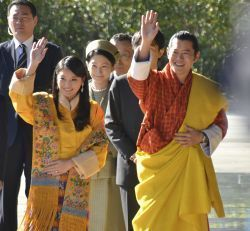 Bhutan's King Wangchuck and Queen Wangchuck wave during their welcoming ceremony at the Imperial Palace in Tokyo